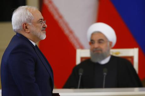 Iranian Foreign Minister Javad Zarif is seen as Iranian President Hassan Rouhani (rear) and Russian President Vladimir Putin (not seen) hold a joint press conference after their meeting in Moscow, Russia on March 28, 2017. ( Sefa Karacan - Anadolu Agency )