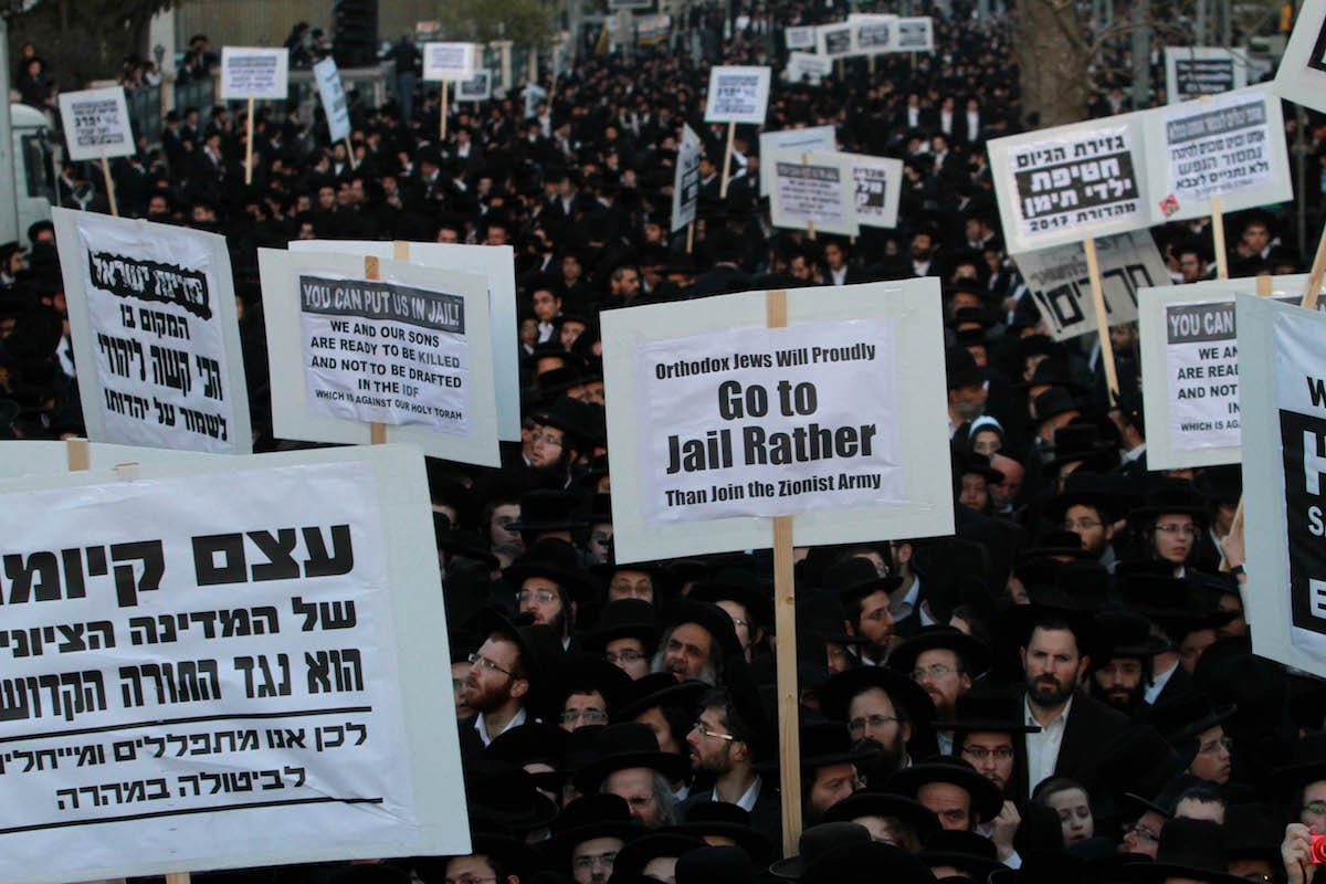 Ultra Orthodox Jewish people stage a protest against compulsory military service in Jerusalem on March 28, 2017 (Gil Cohen Magen - Anadolu Agency )