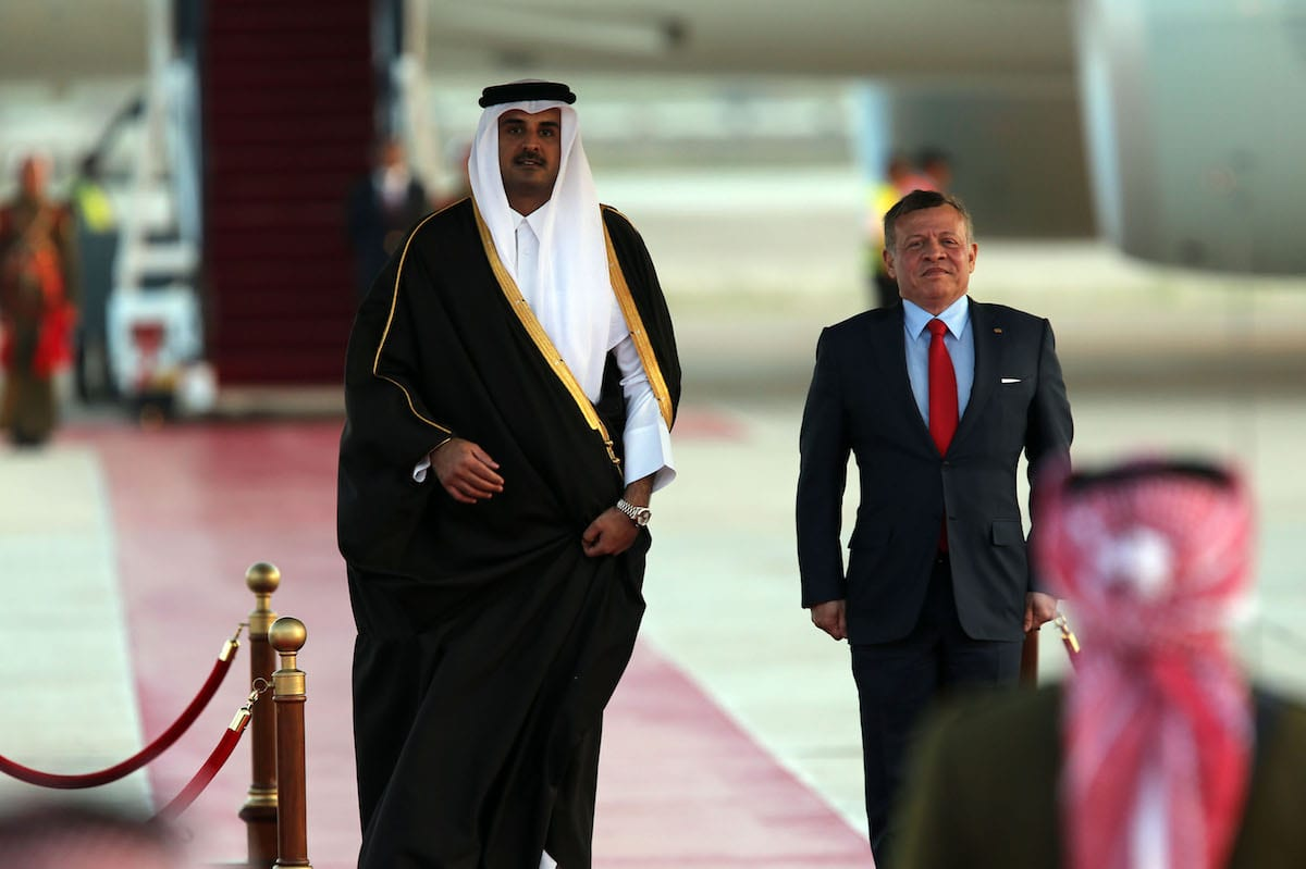 Emir of Qatar, Tamim bin Hamad Al Thani (L) is welcomed by Jordan's King Abdullah II (R) at the 28th Arab League Summit in Amman, Jordan on March 28, 2017 (Salah Malkawi/Anadolu Agency )