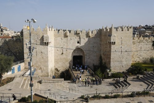 Israeli police are seen in front of the Damascus gate in the Old City of Jerusalem on 29 March 2017 [Mostafa Alkharouf/Anadolu Agency]