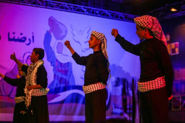 Children perform a musical named 'Photographs' during the commemoration titled 'Our Land is Our Identity', organized by Culture and Free Thought Association (CFTA) of Palestine, as part of 41st Palestinian Land Day at The Rashad Shawa Cultural Centre in Gaza City, Gaza on March 29, 2017 (Mustafa Hassona - Anadolu Agency )