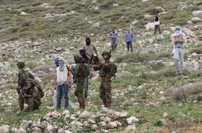"Israeli soldiers harass Palestinians, who gathered for a tree planting event on ""Palestinian Land Day"", in the Madma village of Nablus, West Bank on March 30, 2017. ( Nedal Eshtayah - Anadolu Agency )"