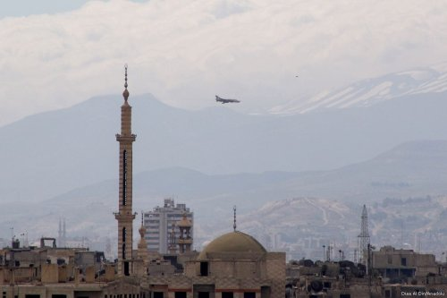 Assad regime forces flies over the region after carrying out airstrikes in Jobar district of Damascus, Syria on March 20, 2017. ( Diaa Al Din - Anadolu Agency )