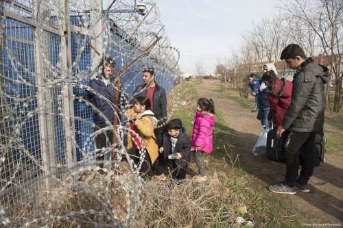 A Syrian family waits next to the border gate, after they were selected to claim asylum in Hungary at the Kelebija border crossing , Subotica, Serbia on March 23,2017 [Omar Marques / Anadolu Agency]