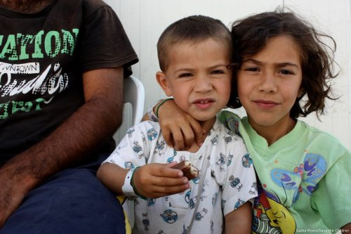 Safa* and Bari* are stranded with their third sibling and parents on Chios, Greece [Sacha Myers/Save the Children]
