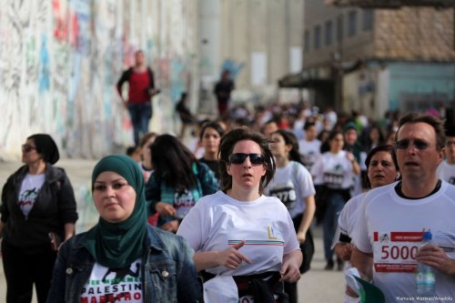 Runners take part in the 5th Palestine Marathon in Bethlehem, West Bank, March 31, 2017. ( Mamoun Wazwaz - Anadolu Agency )