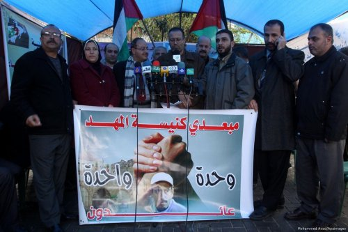Families of the Palestinians who taken by Israel from the Church of the Nativity in Bethlehem take part in a protest calling for their return in front of UN headquarters in Gaza 24 March 2011 [Mohammed Asad/Apaimages]