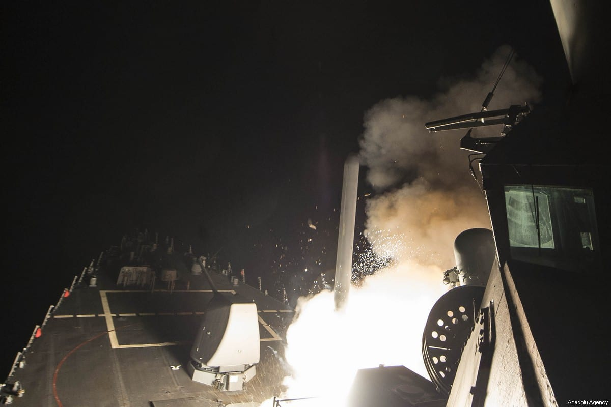 USS Ross (DDG 71) fires a tomahawk land attack missile 7 April 2017. The US fired 59 Tomahawk missiles at a Syrian military airbase American officials believe was used to carry out a deadly suspected chemical attack, the Pentagon confirmed. [Robert S. Price/US Navy]