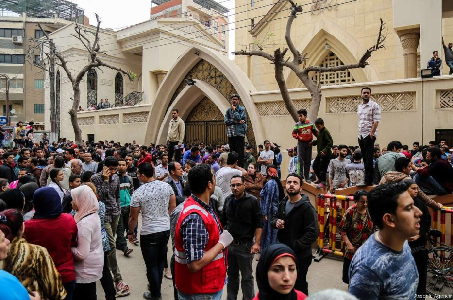 TANTA, EGYPT - APRIL 9: People gather in front of the Saint George church after a bomb struck inside the church in the Nile Delta city of Tanta, Egypt on April 9, 2017. At least 21 people were killed. ( Ibrahim Ramadan - Anadolu Agency )