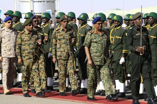 Sudanese President Omar al-Bashir (R-2) attends the joint Sudan and Saudi Arabia air force drill at the Marwa air base which is 350 km south of Khartoum, Sudan on April 9, 2017 [Ebrahim Hamid / Anadolu Agency]