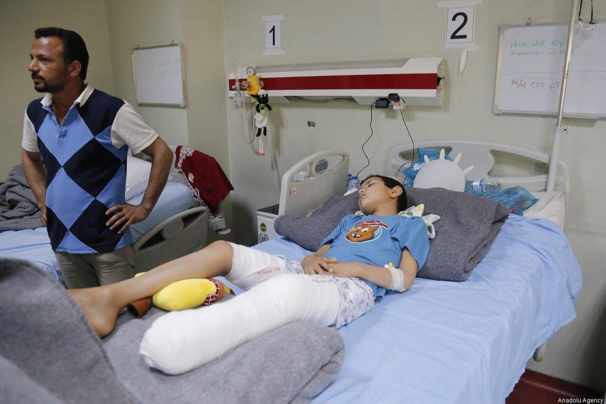 A boy, who has a casted leg, receives treatment at a hospital in Erbil, Iraq on 12 April, 2017 [Yunus Keleş/Anadolu Agency]