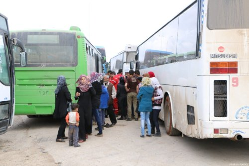 Syrian regime supporters arrive at Syria's Rashidin area by bus under a deal between regime and opposition forces on April 14, 2017. ( Bilal Baioush - Anadolu Agency )