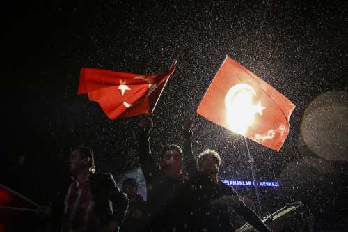 """'Yes' supporters celebrate their victory at July 15th Kızılay National Will Square following the unofficial preliminary results of Turkey's constitutional referendum show """"Yes"""" votes in Ankara, Turkey on April 16, 2017. (Murat Kula - Anadolu Agency)"""