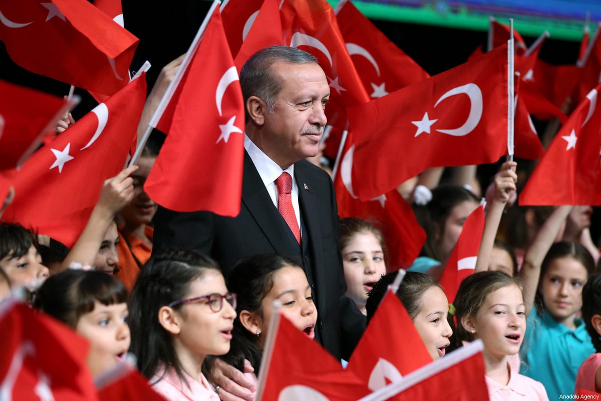 Turkish President Recep Tayyip Erdogan seen with children at Bestepe People's Culture and Congress Centre during a ceremony as part of the National Sovereignty and Children's Day, at Presidential Complex in Ankara, Turkey on April 23, 2017 [Turkish Presidency / Murat Cetinmuhurdar - Anadolu Agency]