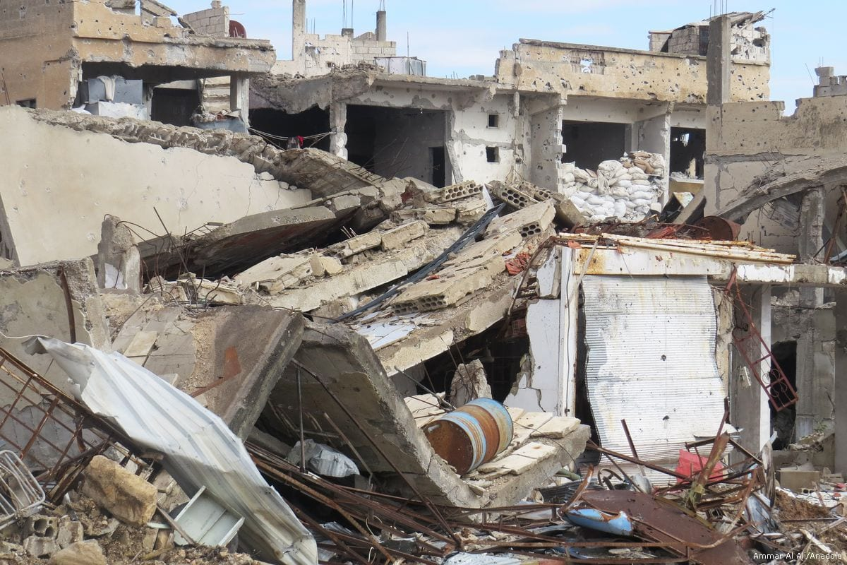 Destroyed buildings are seen after the Syrian regime carried out airstrikes in Daraa, Syria on 10 April 2017 (Ammar Al Ali/Anadolu Agency )