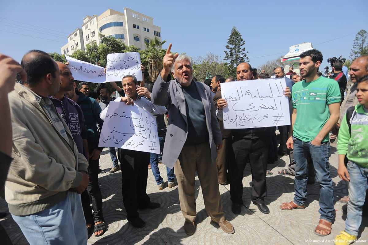 Palestinian Authority employees stage a protest after 30% is cut from their salaries, seen on April, 2017