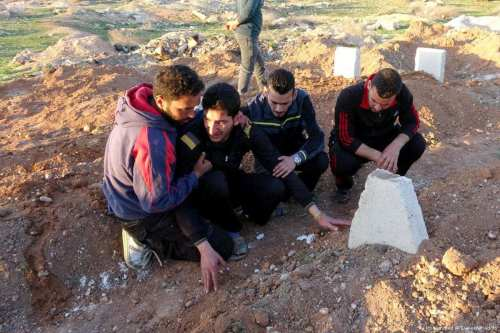 Abdel Hameed Alyousef (2nd L) mourns over his wife and twin babies, killed in the chemical attack carried out by the Assad Regime, in Idlib, Syria on 6 April 2017 (Mohammed Al Daher/Anadolu)