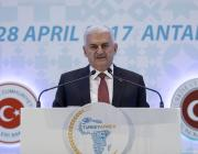 Turkish Prime Minister Binali Yildirim delivers a speech during the Turkey-Africa First Agriculture Ministers Meeting and Agribusiness Forum in Antalya, Turkey on 27 April 2017 [Ali Balıkçı/Anadolu Agency]