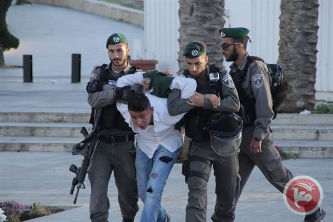 Israeli forces arrest a Palestinian in Jerusalem at a protest showing solidarity with the 1,500 Palestinian prisoners on hunger strike in Israeli prisons