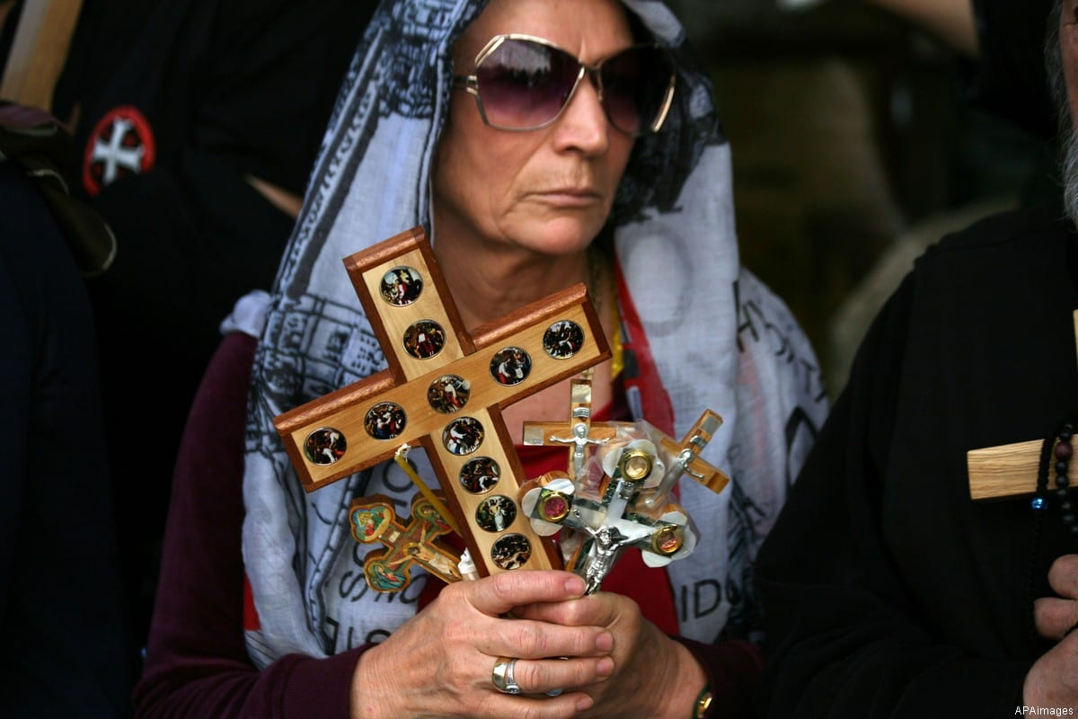 Christian Orthodox pilgrims participate in a procession marking Good Friday on April 18, 2014 in Jerusalem's old city [Photo by APAimages / Saeed Qaq]