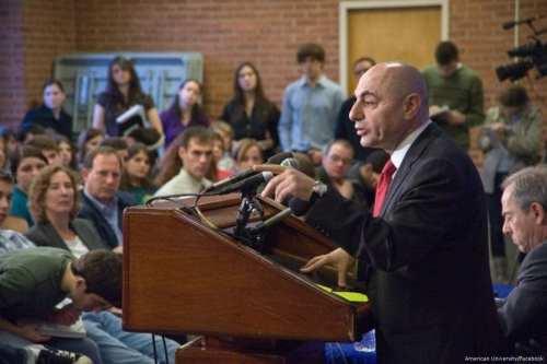 Image of Syrian Ambassador to Beijing, Imad Mustafa at a press conference [American University/Facebook]