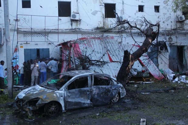 A damaged car and broken shutters are seen after a bomb exploded in Mogadishu, Somalia on May 8, 2017 [Sadak Mohamed/Anadolu Agency]