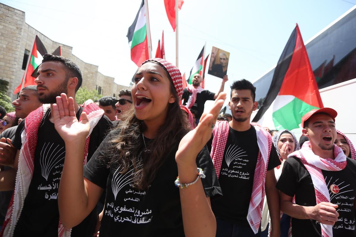 Students who support Popular Front for the Liberation of Palestine's, gather to attend the debate held ahead of the student council elections, at Bir Zeit University in Ramallah, West Bank on May 09, 2017 [Issam Rimawi / Anadolu Agency]