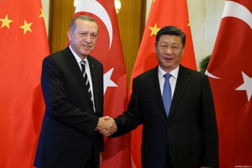 Turkish President Recep Tayyip Erdogan (L) and Chinese President Xi Jinping (R) shake hands during their meeting in Beijing, China on May 13, 2017 [Turkish Presidency / Yasin Bülbül / Anadolu Agency]