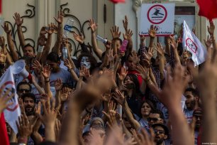 People hold banners during a protest against government's bill on Economic and Financial Reconciliation in Tunis, Tunisa on April 29, 2017 [ Amine Landoulsi / Anadolu Agency]