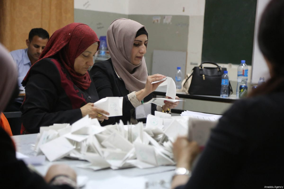 Officials count ballots after Palestinians living in Israel-occupied West Bank voted in the local election, which is boycotted by several Palestinian groups, at the Banat Qasm High School in Ramallah, West Bank on May 13, 2017 [Issam Rimawi / Anadolu Agency]