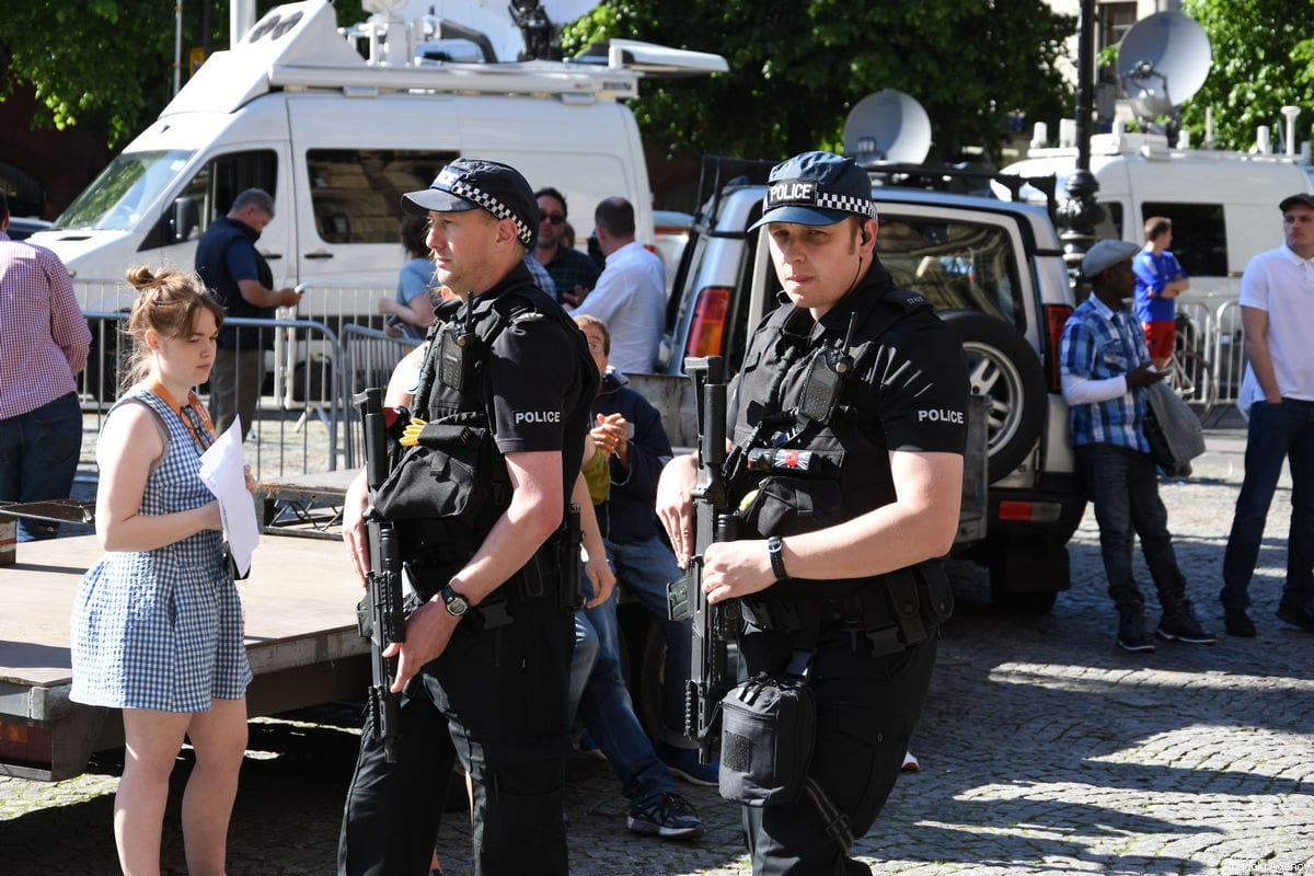 Police take security measures during a commemoration ceremony held for explosion victims of Manchester Arena stadium, at Albert Square in Manchester, United Kingdom on May 23, 2017 [Behlül Çetinkaya / Anadolu Agency]