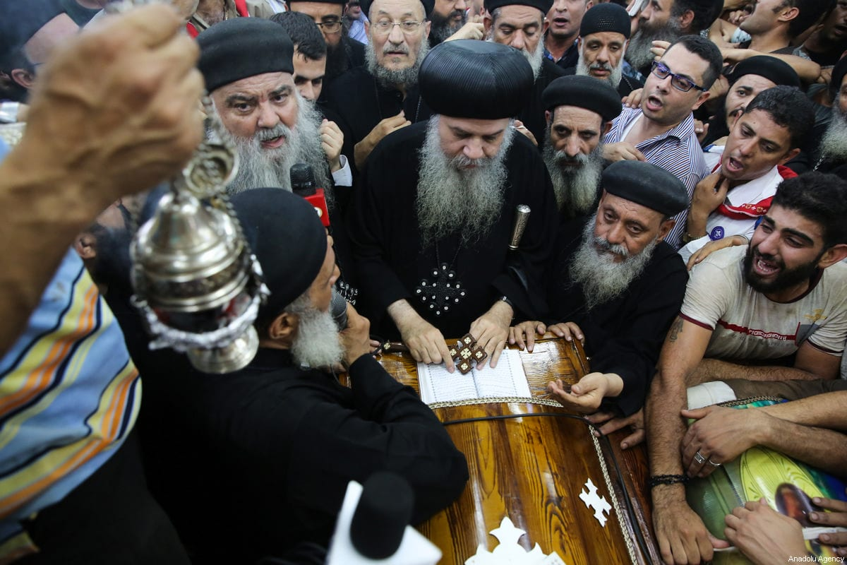 Relatives of Saint Samuel's Monastery attack victims Cercis Mahrous and Beshavi Ibrahim mourn during a funeral ceremony at Maghagha Church in Cairo, Egypt on May 26, 2017 [Ahmed Al Sayed / Anadolu Agency]