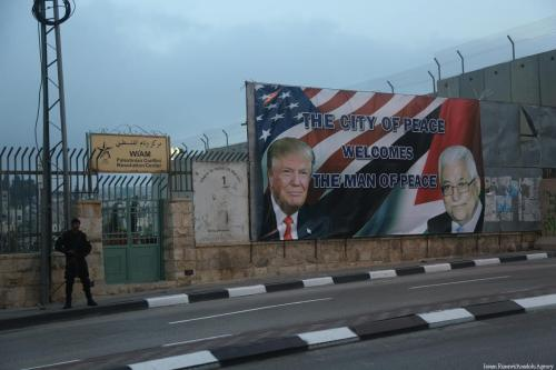 Poster of US President Donald Trump and Palestinian President Mahmoud Abbas are seen before US President Donald Trump's visits in Bethlehem, West Bank on 23 May, 2017 [Issam Rimawi/Anadolu Agency]