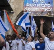 Settlers parade Israeli flags in East Jerusalem