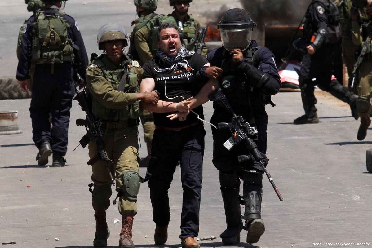 Israeli security forces arrest a Palestinian protesters during a demonstration in support of hunger striker Palestinian prisoners held in Israeli jails in Nablus, West Bank on May 25, 2017 [Nedal Eshtayah/Anadolu Agency]
