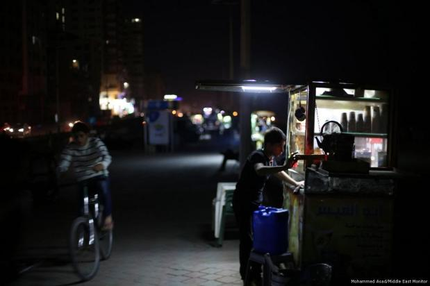 A Palestinian man is seen trying to use a generator to generate electricity due to severe shortages in Gaza [Mohammed Asad/Middle East Monitor]