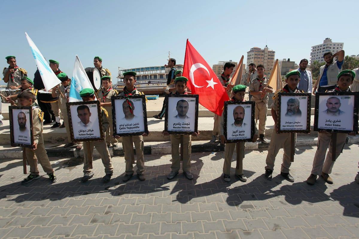 Palestinians hold flags during a rally marking the anniversary of the Mavi Marmara Gaza flotilla attack, at the seaport of Gaza City [Ashraf Amra/ApaImages]