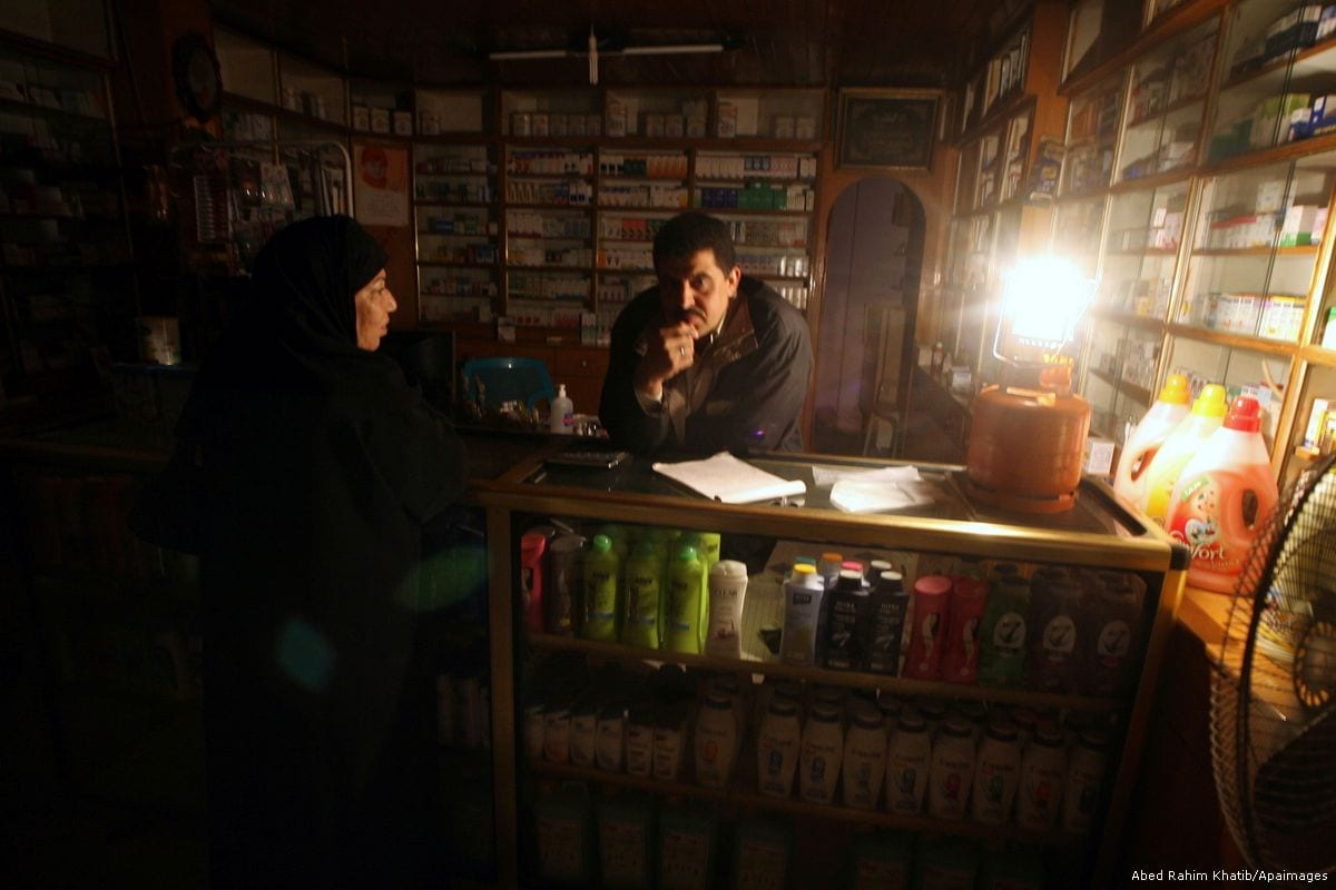 A Palestinian man has lit a gas lantern during a power shortage in Rafah, Gaza on 27 January 2012 [Abed Rahim Khatib/Apaimages]