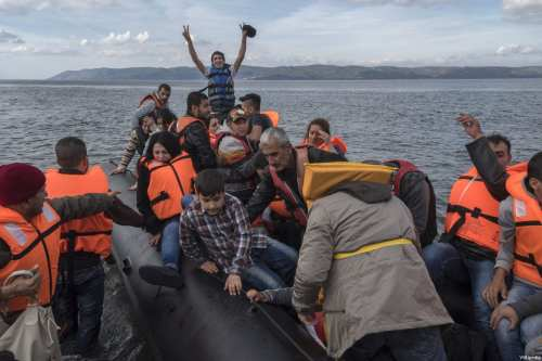 An inflatable boat with Syrian Refugees arrives at Skala Sykamias, Lesvos island, Greece on 29 October 2015 [Ggia / Wikipedia]