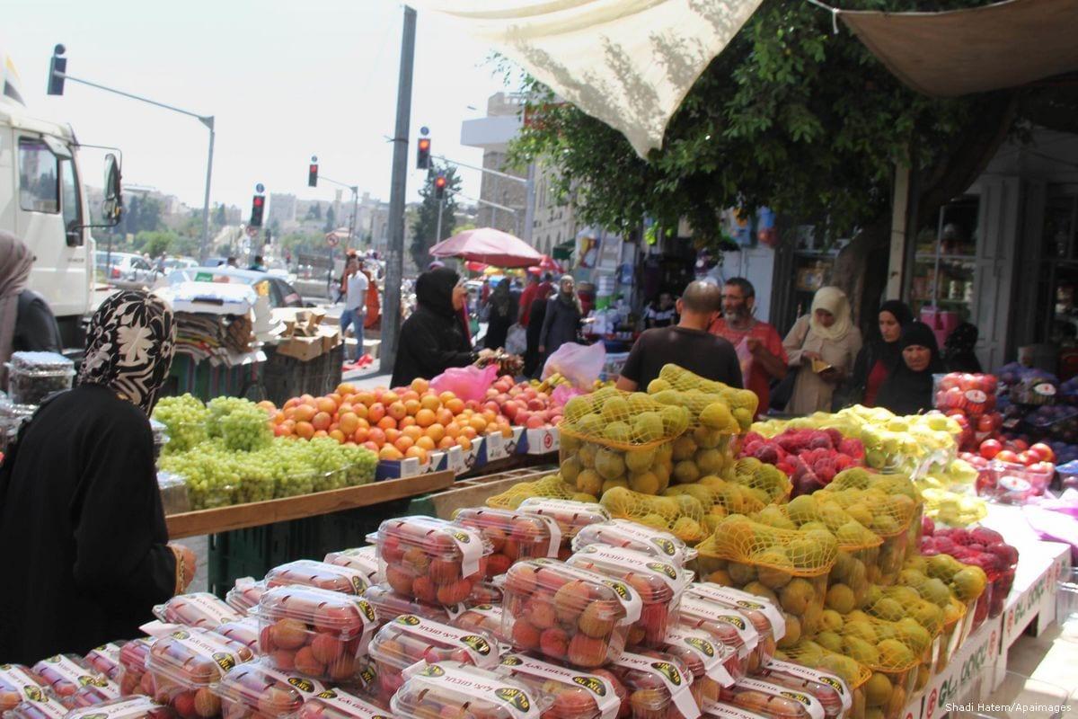 Palestinians shop at a market in preparation for Eid on 5 July 2016 [Shadi Hatem/Apaimages]