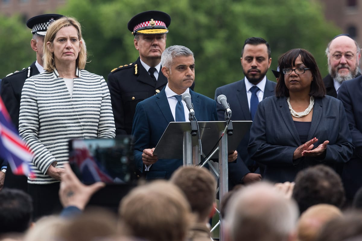 Home Secretary Amber Rudd (L), Mayor of London Sadiq Khanc (C) and Labour party MP Diana Abbott (R) speak at a vigil at City Hall to honour victims of the London Bridge terrorist attack in London, England on 5 June, 2017 [Ray Tang/Anadolu Agency]
