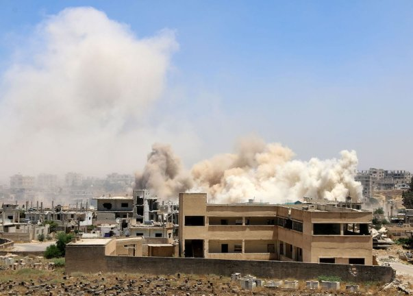 Smoke rises after attacks by the Assad regime took place in Daraa, Syria on June 7, 2017 [Muhammed Yusuf/Anadolu Agency]
