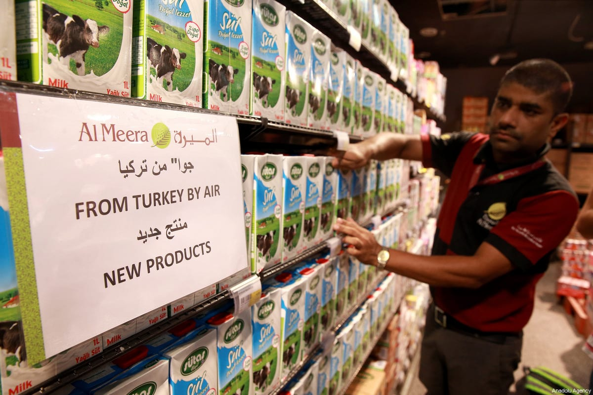 Qatar bans goods from UAE, Saudi as embargo anniversary approaches ... Middle East Monitor A store attendant tidies the shelves at Al Meera market in Doha, Qatar on June