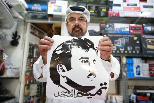 People in Qatar hang posters of Turkish President Recep Tayyip Erdogan and Emir of Qatar Sheikh Tamim bin Hamad Al Thani to react blockade applied to Qatar, in Doha on 12 June, 2017 [Mohamed Farag/Anadolu Agency]