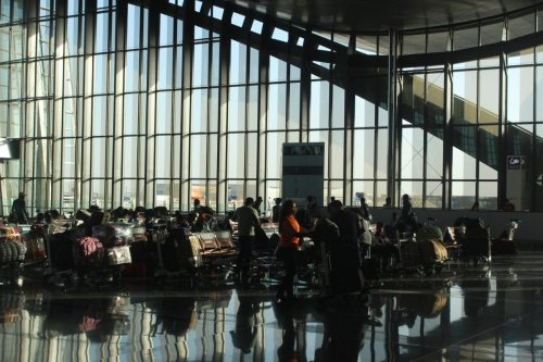 People wait ahead of their flights as air traffic flow continue as normal as before despite of a land, sea and air blockade applied by Saudi-led Arabic countries, at Hamad International Airport in Doha, Qatar on June 12, 2017 [Ahmed Youssef Elsayed Abdelrehim / Anadolu Agency]