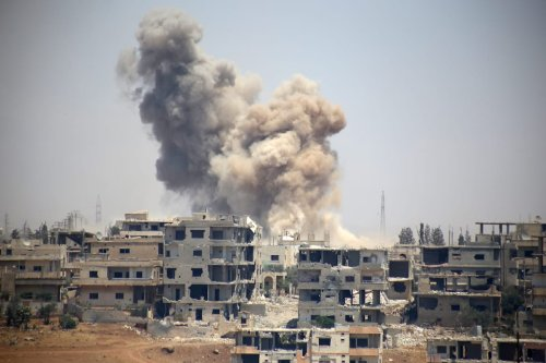 Smoke rises after the Assad regime carried out airstrikes in Daraa, Syria on 14 June 2017 [Muhammed Yusuf/Anadolu Agency]