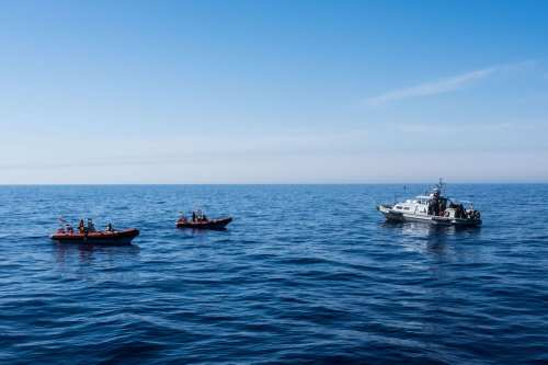 Spanish NGO Proactiva Open Arms and Libyan Coast Guards are seen in the Mediterranean Sea, near Libya on Thursday, June 15, 2017 [Marcus Drinkwater / Anadolu Agency]
