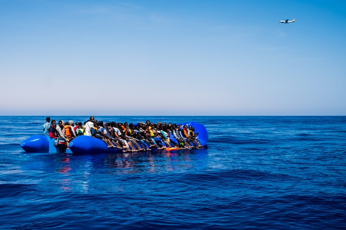 Refugees are seen after being rescued from the Mediterranean Sea on 15 June 2017 [Marcus Drinkwater/Anadolu Agency]