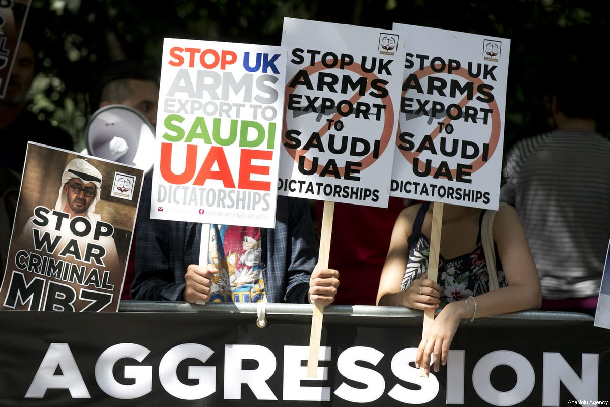 People hold placards during a protest against the Saudi-UAE led aggression on Qatar in an emergency protest called by the international campaign for Justice & Peace outside the United Arab Emirates Embassy in London, United Kingdom on 17 June, 2017 [Isabel Infantes/Anadolu Agency]