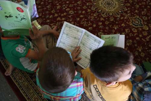Syrian children learn about Quran, the Holy book for Muslims at the Beqaa Valley in Beirut, Lebanon 22 June 2017 [Ratib Al Safadi/Anadolu Agency]